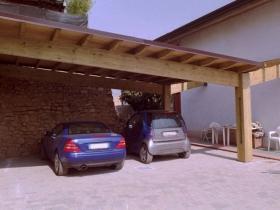 Tre posti auto in lamellare